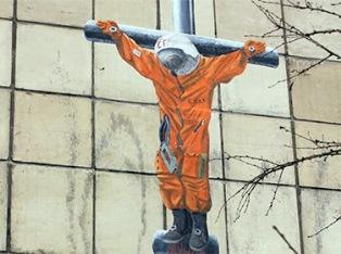 Граффити с распятым Гагариным